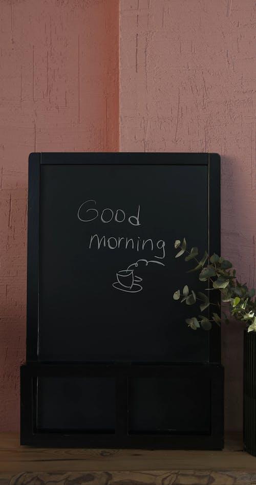Erasing The Morning Greetings Written In Chalk On A Blackboard