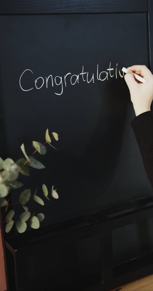 Congratulation Written In Chalk On A Blackboard