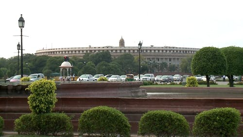 View Of The House Of Parliament In New Delhi, India From The Park Across