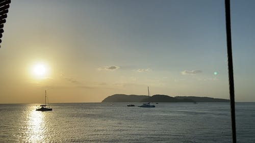 Footage Of The Sea And The Boat With Sunset