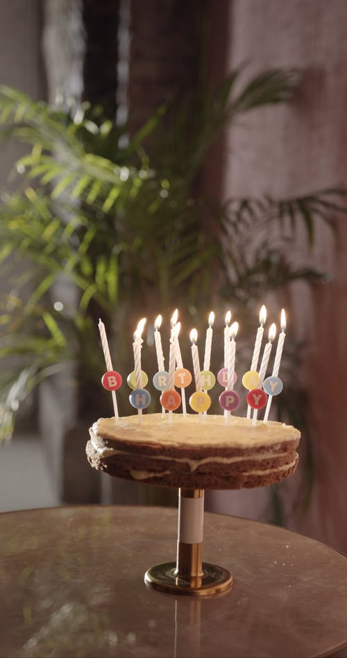 A Single Missed Candle Unlit Among A Set Lighted On a Birthday Cake