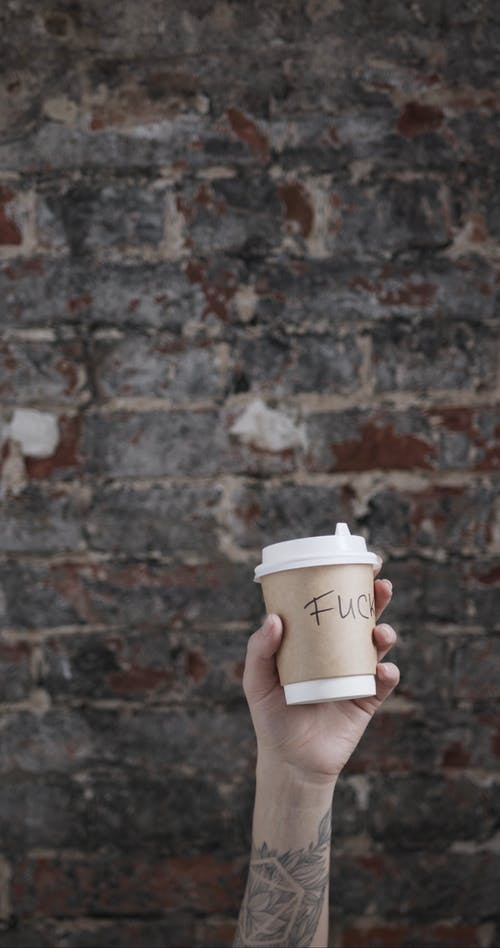 Throwing A Disposable Cup Of Coffee