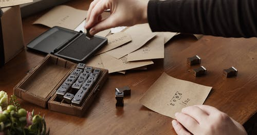 Stamping Words Of Wishes On Paper Using Letter Rubber Stamps