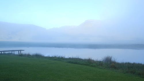 Fogs Covering The Lake In Early Morning