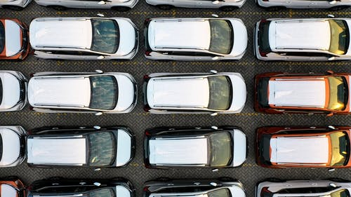 Aerial Footage Of Cars On A Parking Lot