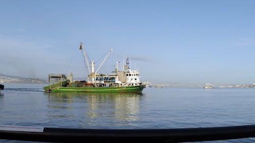 Panning Shot of a Ship at Sea