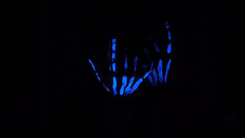 A Hands Drawn With Neon Paint Making A Come On Sign In The Dark