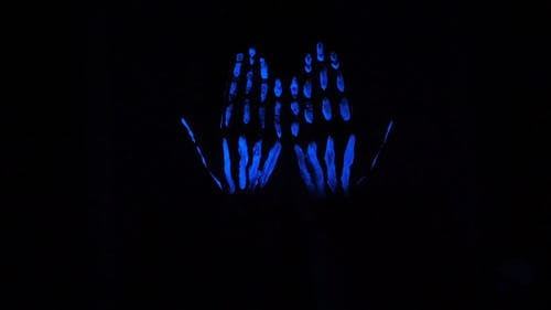 Slow Motion Video Of Hand Glowing In The Dark