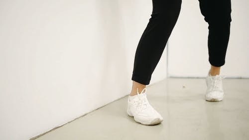 A Person Dancing Feet Wearing White Sneakers
