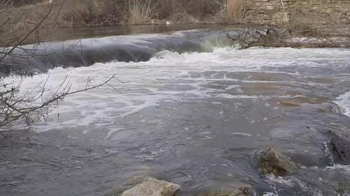 Footage Of The River With Small Falls