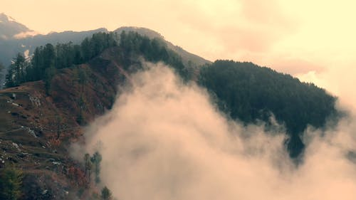 Drone Footage Of Thick Fog Creeping In The Mountain Side