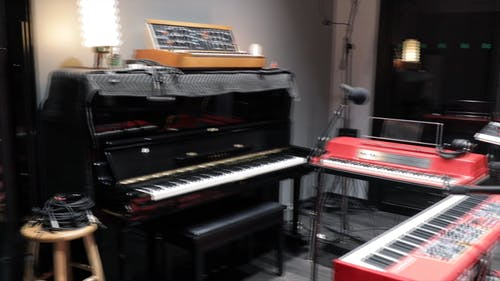 An Empty Studio With Piano And Keyboarrds
