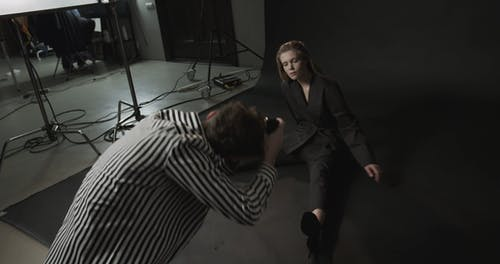 A Model Collaboration With A Photographer In A Photo Shoot