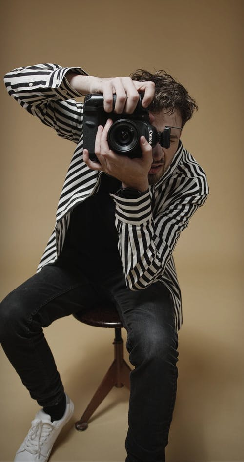 Video Footage Of A Male Photographer In Action