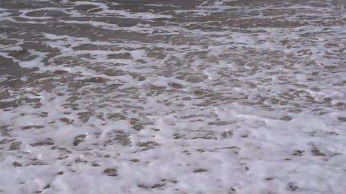 Close Up Shot of Waves Crashing on the Seashore