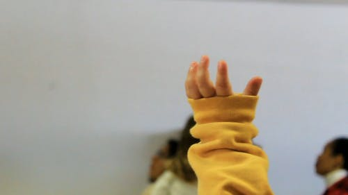 A Baby's Hand Raised Up in Worship