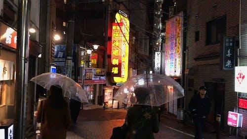Walking In a Street In Asia