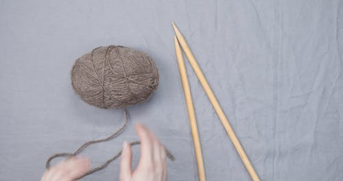 Knitting A Ball Of Fiber Thread Into Shape