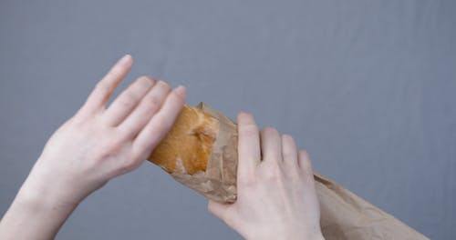 Cutting By Hand A Freshly Baked Baguette