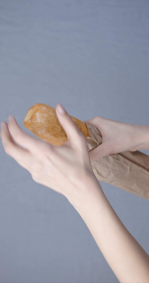 Cutting By Hand A Fresh French Bread