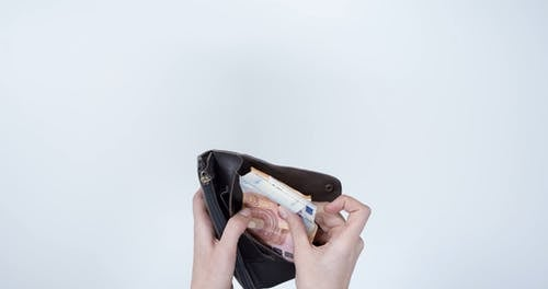 Selecting A Bill From Inside The Wallet