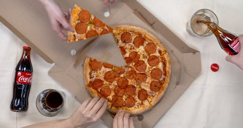 Grabbing A Slice Of Pizza Partner With A Drink Of Soda