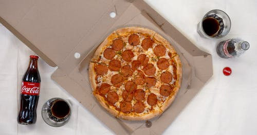A Meal Of Coke And Pepperoni Pizza