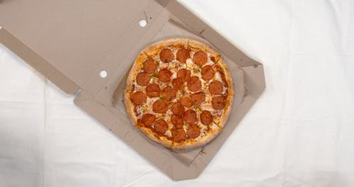 Sharing And Returning The Slices Of Pizza From The Box