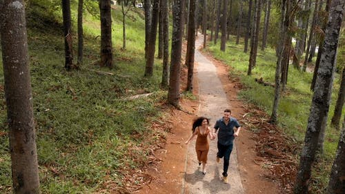 Footage Of Couple Running In Slow Motion