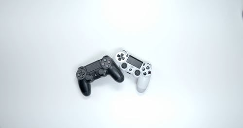Grabbing The Game Console Wireless Controllers