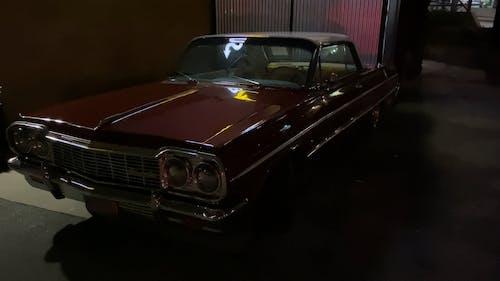 A Vintage Car Parked on a Garage