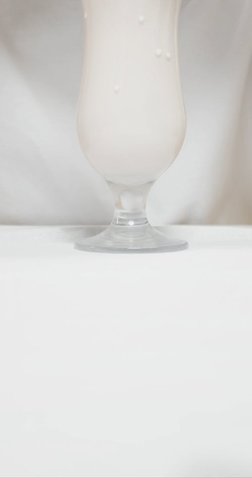 Sipping A Milk Shape Through A Hole Punctured In A Mask