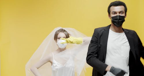 Newly Wed Couple Dancing With Face Masks And Gloves