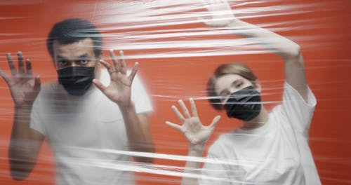 A Couple In Quarantine Inside An Isolation Area Sealed With Plastic