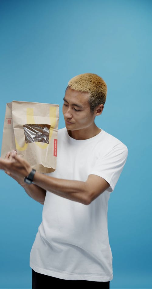A Man Innovative Idea Of Using Paper Bag For Personal Protection