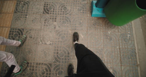 Walking On A Sidewalk With Tiles Flooring