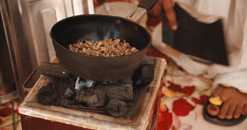 Cooking Caramelized Peanuts Over Charcoal