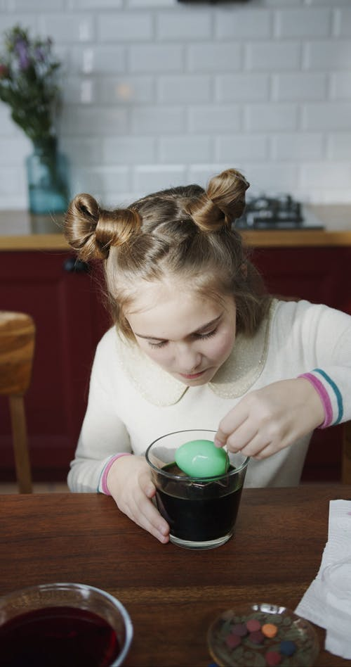 Scooping Out Egg From A Bowl Of Color Green Liquid Dye