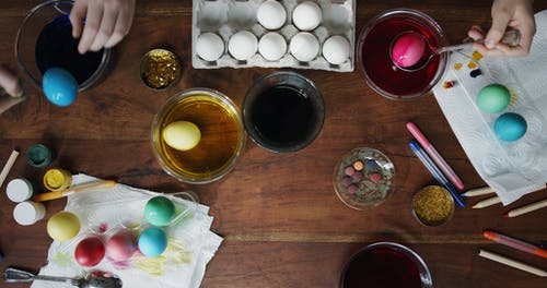 Drying Soaked Egg With Colored Dyes On A Tray Over Paper Towel