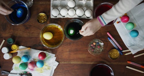 Soaking Eggs On Liquid Coloring To Dye