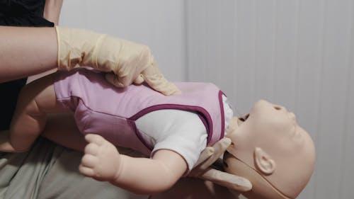 Demonstration Of Cardio Pulmonary Resuscitation On Infants