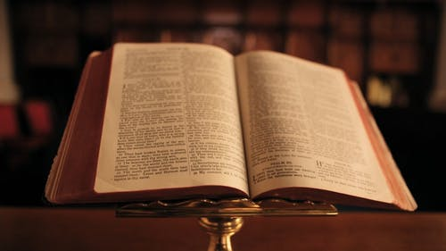 A Bible Open At The Book Of Psalm Pages