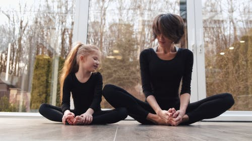 Mother and Daughter Doing Warm Up