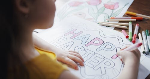 A Girl Is Coloring A Happy Easter Poster