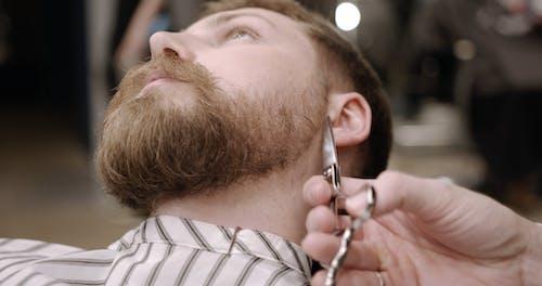 Using Scissor In Trimming A Man's Side Beard