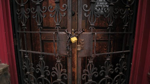 A Closed Rusty Gate With Padlock