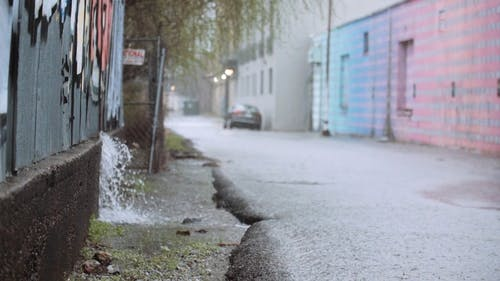 Heavy Rains Falling Over An Asphalt Road