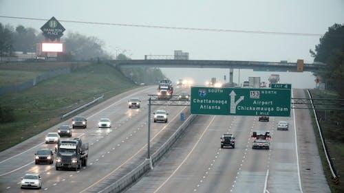 Motor Vehicles Traveling On A Multi Lane Highway