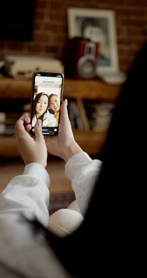 Mobile Camera Image Of Two Women Taking Selfie Photo Together