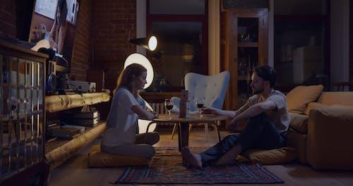 A Couple Playing A Game Of Jenga